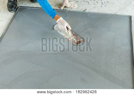 worker are plastering mixed cement terrazzo on the mold