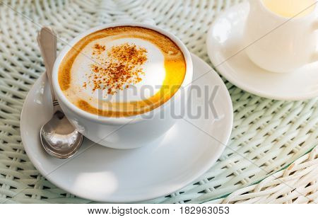 Cappuccino coffee topping with powder on the table