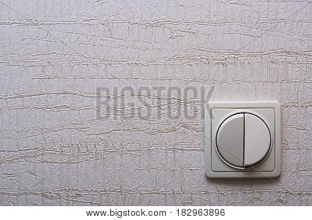 wall with Wallpaper and a switch located at the bottom right