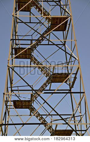 Closeup of the metal steps and landing platforms of af old historic fire lookout tower