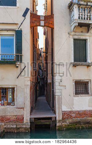 Narrow Street In Venice City In Spring
