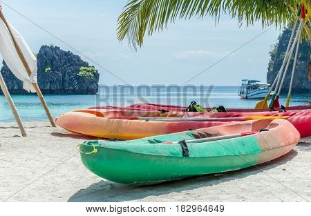 Kayak boat on the white sand beach at the sea with blue sky prepare for kayaking.