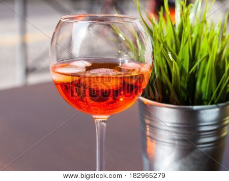 Glass Of Spritz Drink With Ice On Table