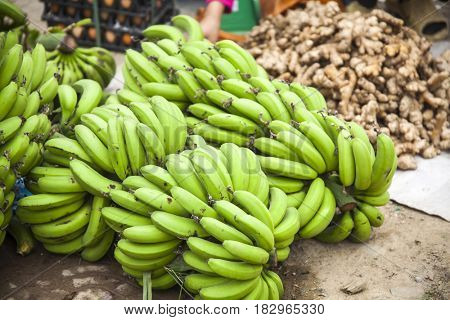 Green banana bunch at a local fruit and vegetable market in Sapa, Vietnam