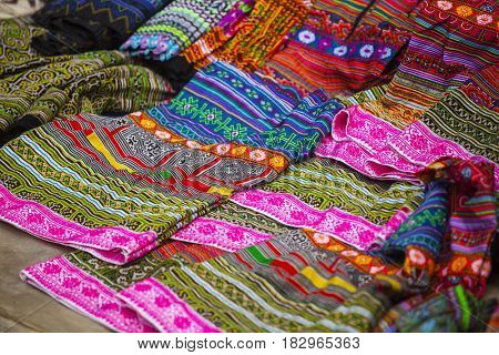 Handmade textiles for sale in the rural market of Sa Pa.