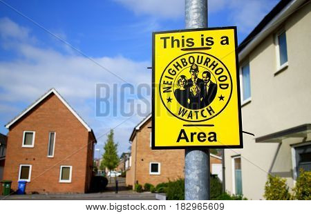 Bracknell, England - April 12, 2017: Sign warning This is a Neighbourhood Watch Area on a housing state in Bracknell, England. The association aims to bring communities together and reduce crime