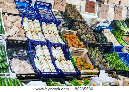 travel to Italy - fresh seasonal local vegetables on market on Piazza delle Erbe near Palazzo della Ragione in Padua city in spring