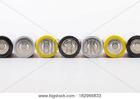Energy abstract background of different batteries. AA size alkaline battery.