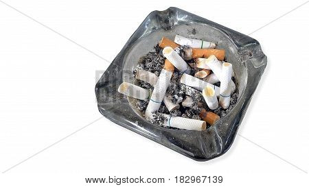 Ashtray and butted out cigarettes isolated on white background