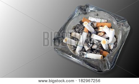 Ashtray and butted out cigarettes isolated on gradient grey background