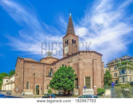 Side view of Church of San Marco in Milan, Italy. Dedicated to St. Mark. Beautiful wide angle picture with colorful blue sky and white clouds