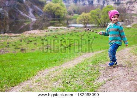 A Boy Walks Through A Meadow.
