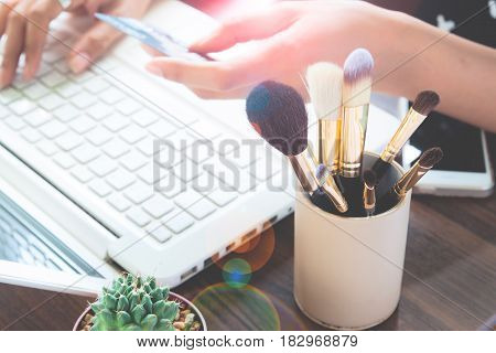Girl using credit card and laptop computer for online shopping Beauty and Online shopping concept