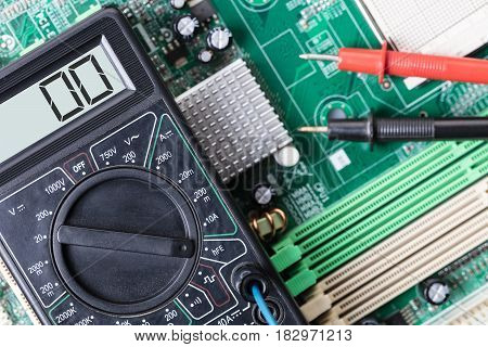 Electronic measuring tool close-up on a computer board
