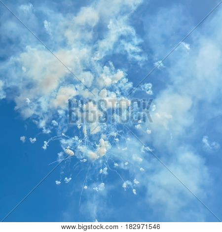 blue sky with fireworks firecrackers and smoke in day time Ischia Italy