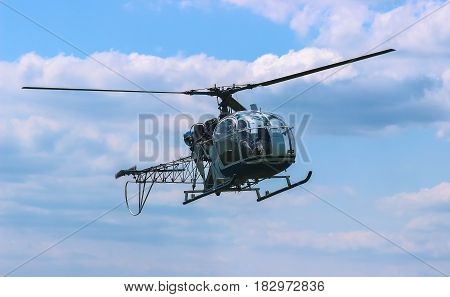 helicopter fly near the forest at iron chain