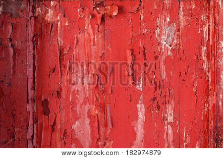 Painted red old wooden wall texture, rustic background.