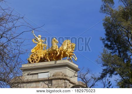 Golden statue of a chariot on Cascada fountain in Barcelona Spain