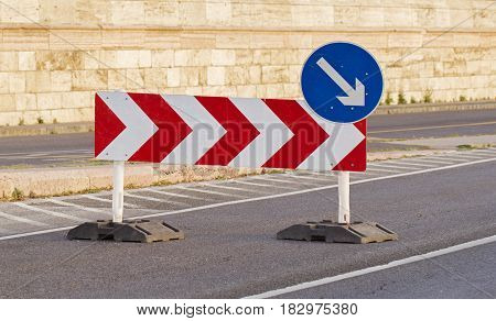 Sign on the road meaning a detour on the right