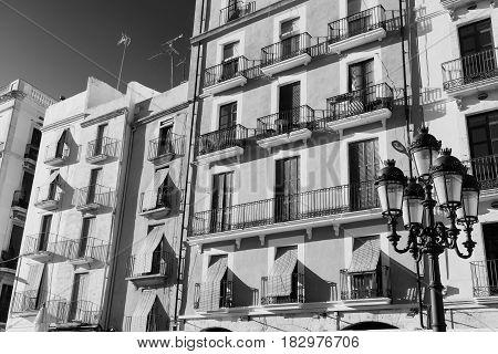 Tarragona (Catalunya Spain): old colorful houses in the Plaza del Ayuntamiento. Black and white