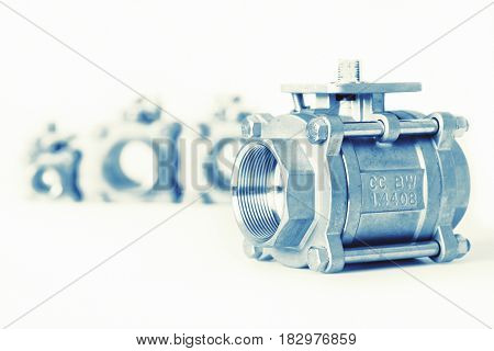Group 4 valves different sizes ball valve with selective focus on thread fittings Stainless steel valve