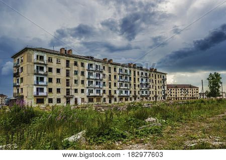 YUBILEYNY PERM KRAI RUSSIA - JULY 12 2016: Abandoned building in the dead city on a summer day in cloudy weather