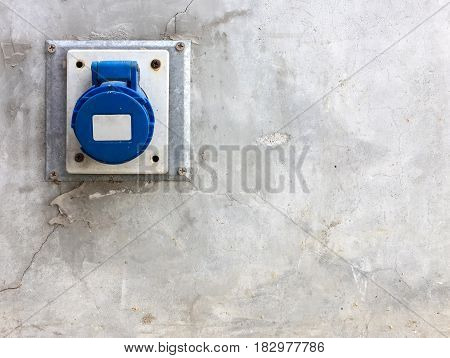 Main outlet port with the plastic cover on the cement wall of the factoryCopy space.