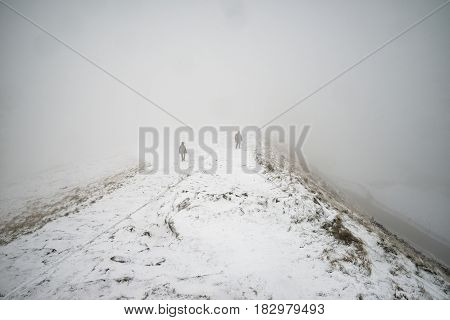 Beautiful Winter Landscape Image Around Mam Tor Countryside In Peak District England With Hikers In