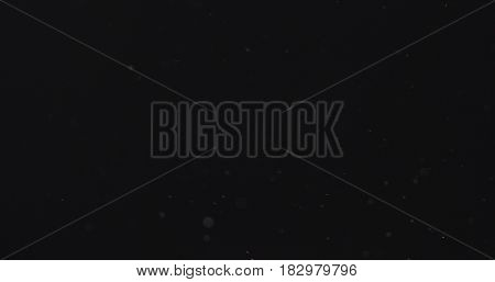 dust particles fast moving over black background from right, 4k photo