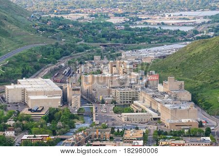 GOLDEN USA - MAY 26 2016: Overlook of the Coors brewery in Colorado with several buildings roads and tracks with cars and trains and a creek running through the facility.