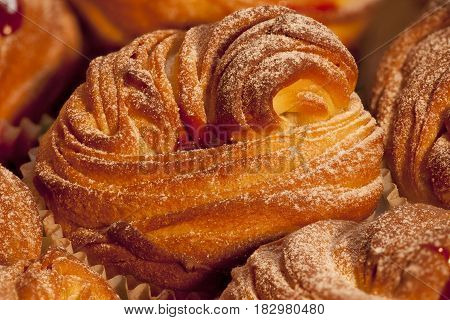 American cruffins with jam Sprinkled with powdered sugar background