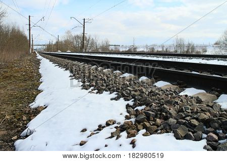 rails of railway forward go into distance at winter