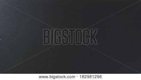 dust particles fast moving over black background from left corner, 4k photo