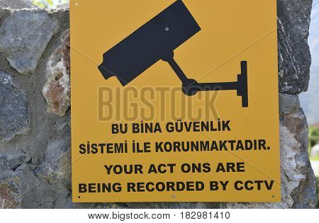 Close-up of a misspelled CCTV sign picture from the North of Cyprus.