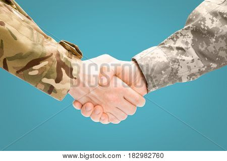 Two Military Men Shaking Hands On White Background - Close Up Studio Shot