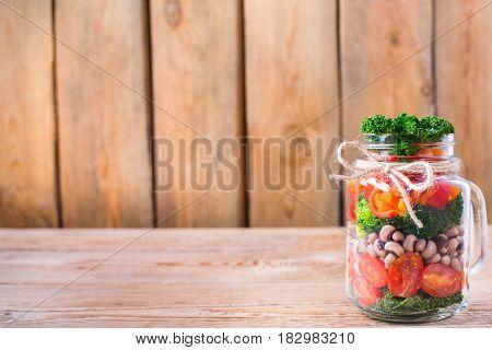 Healthy Vegan Salad In A Mason Jar With Beans