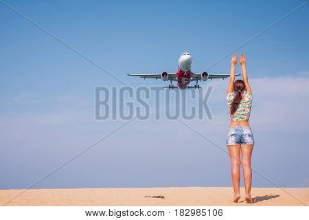 PHUKET THAILAND - MARCH 04 2017: Unidentified girl poses to take photo with the plane was landing phuket international airport near Mai Khao Beach on Phuket Island in Thailand.