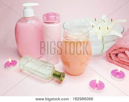 spa hair mask creme liquid soap candles towel essenses and white lily