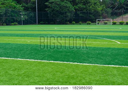 a beautiful soccer field horizontal composition in day time