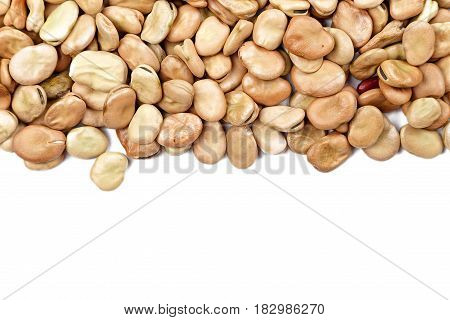Dried broad beans are scattered on a white background a place for a recipe