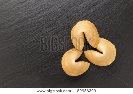 traditional Chinese pastry with the wishes or predictions on a black background