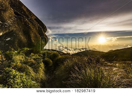 colorful sunset above brasil mountains with yellow sun and clouds