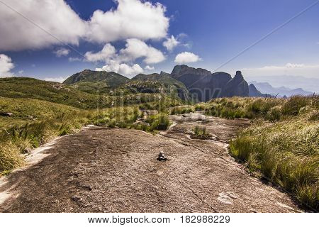 brasil mountains with green forest and steep rocks with blue sky and clouds at daylight