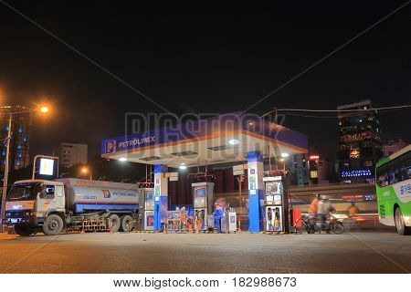 HO CHI MINH CITY VIETNAM - NOVEMBER 25, 2016: Unidentified people buy gasoline at Petrolimex petrol gas station.