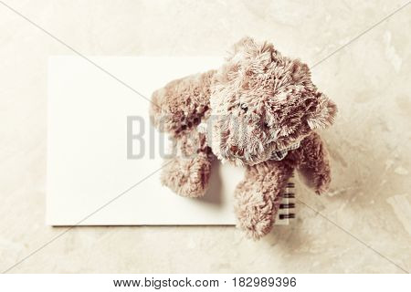 Vintage Teddy Bear on a drawing pad (from above)