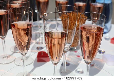 Glasses full of champagne on a Table