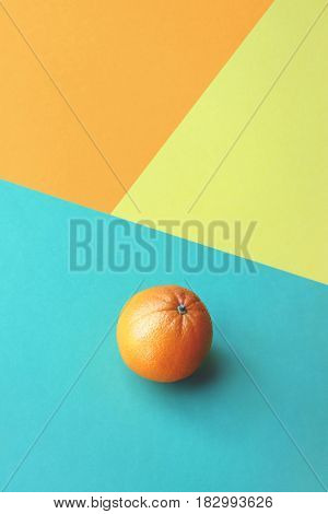 Orange over a colorful background.