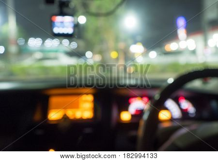 Blur photo background of car interior and street light bokeh