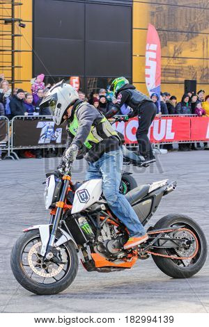 St. Petersburg Russia - 15 April, Moto freestyle sports group,15 April, 2017. International Motor Show IMIS-2017 in Expoforurum. Sports motorcycle show of bikers on the open area.