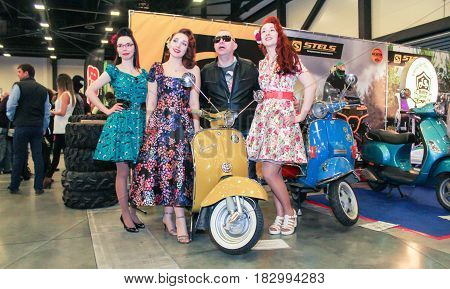 St. Petersburg Russia - 15 April, Visitors and motorcycles. Photo with models in dresses,15 April, 2017. Visitors and participants of the annual moto-salon in St. Petersburg.